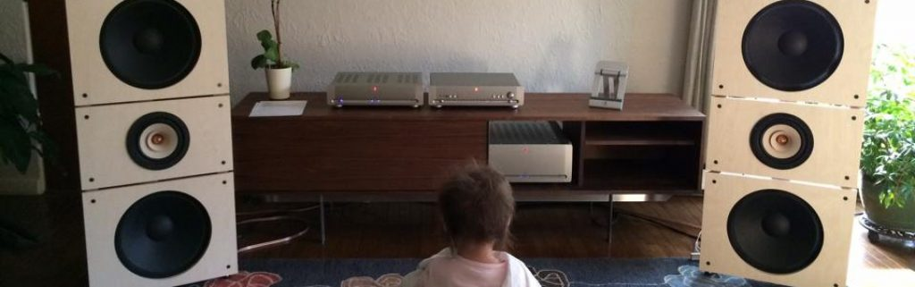 cropped-Trio15TB-with-baby-listening.jpg